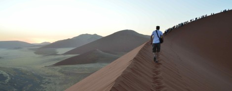Walking up the dune just before sunrise