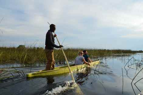 Poling through the Okavango Delta, Botswana, in a mokoro
