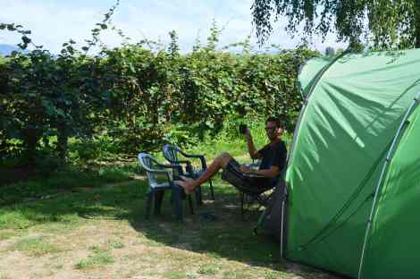 Erik and our Green Igloo in a kiwi orchard