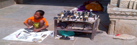 Boy forced to sell hand-crafted sculptures in the street