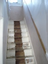 Replastering walls. Now what to do with the stairs!
